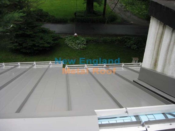 standing-seam ridge-cap installation over the Z bar